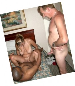 Here comes a very hot cuckolding style threesome. The horny dude invited a black lover for his mature wife & now the hubby watching him fucking his beloved spouse. The blond MILF has nothing against it as she has always been a cuckolding lover. The babe is blessed with a pair of huge natural tits which are now hanging freely as she is riding a black cock. Her cunt is shaved & still looks as a pussy of a slutty young bitch. She is riding the cock getting double pleasure from sex & watching her hubby standing with his cock erected & jerking it off. The husband received what he wanted – he is watching his wife getting fucked in hot interracial action & he is going to cum very well this time. So watch the hot mature perverts & enjoy!